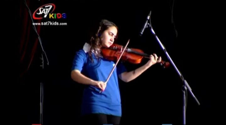SAT-7 KIDS program, AS News portrays girl playing violin