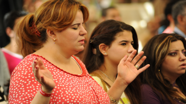 Image of a woman praying from program Experiences